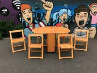 Dining room table and 4 fold away chairs