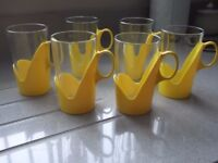 Set of 6 1970s glass with Plastic Holders Mugs
