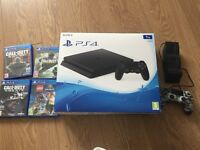 PlayStation 4 1TB with 4 games and extra controller