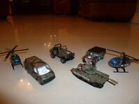Army vehicles including a tank and two helicopters