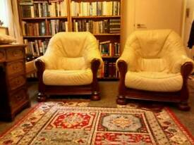 Two cream leather arm chairs