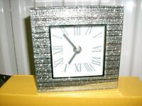 Beautiful mirrored clock with Roman numerals