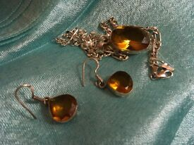 Amber. And Silver pendent and18inch chain