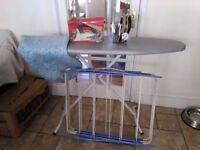 Ironing board and iron, dryer and spare board cover.