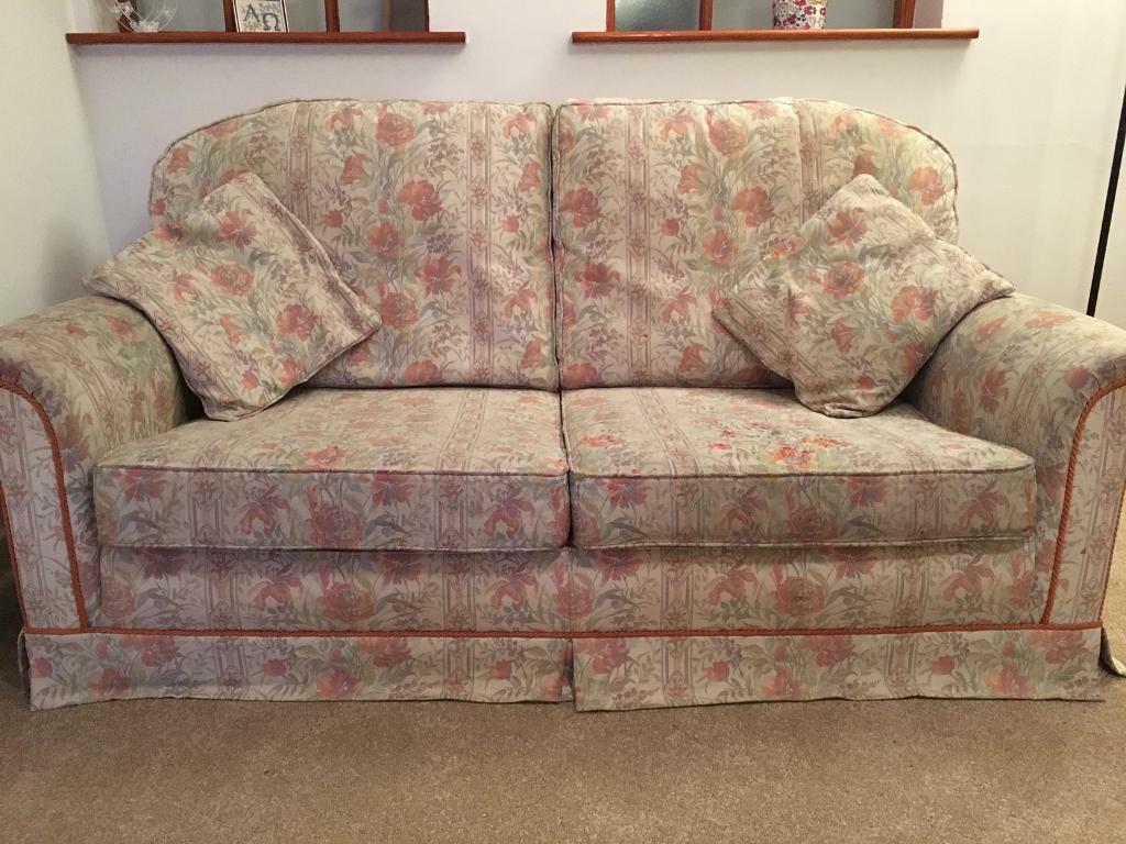 Sofa, 2 arm chairs and foot stool.