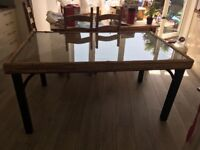 Glass topped dining table