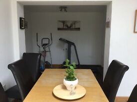 Oak dining table extendable to seat 6-8