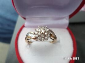 LADIES. 9 CT YELLOW GOLD 0.33 CT DIAMOND RING