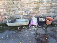 Garden trough, rusty owl bracket, gravel