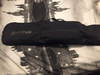 Snowboard, boots, bindings and travel bag for sale