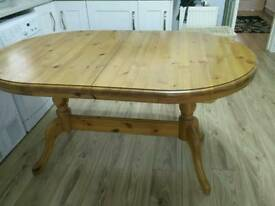 Oval pine extending dining table