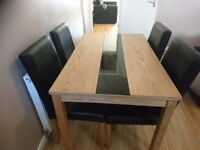 Oak Affect And Black Glass Dining Table With 4 Leather Chairs