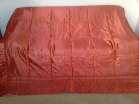 Burnt orange coloured bedspread