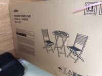 Wooden bistro set with seat pads