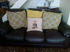 Real leather brown 3 + 2 seater sofas