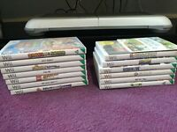 Wii with wifi fit board and nunchucks, 14 games