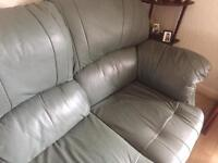 Comfy green leather 3 piece suite.