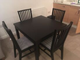 dining room table and chairs in black