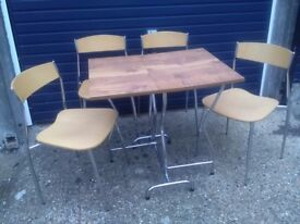 Small folding table and 4 x stackable chairs in good condition