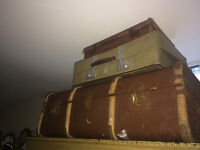 Appealing Stack of Charming Rustic Vintage Suitcases