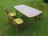 1960 Ercol elm top Dining Table + 4 chairs with original covers.