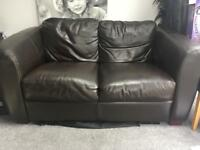 2 x 2 Seater Leather Sofas and Footstool