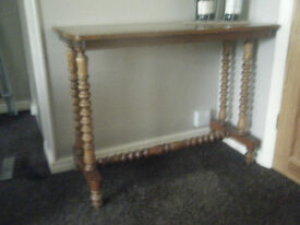 Hall table with marquetry inlay.