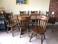 LARGE SOLID DARK WOOD DINING TABLE AND CHAIRS