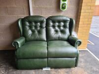 Green leather recliner sofa