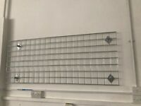 Wall-Mounted Grid Mesh Display