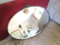 Vintage Art Deco bevelled glass oval mirror with metal detail