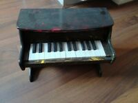 Toy piano - plays well.