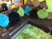 Brown leather DFS corner sofa quick sale £70 no rips or tears .