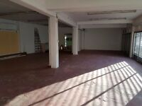 Large commercial space to rent, low rent, leading off from a main high street
