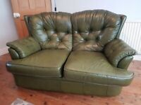 Green leather sofa and matching footstool