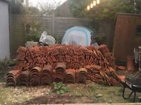 Terracotta roof tiles and chimney stacks