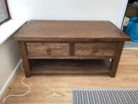 Solid coffee table with drawers and shelf