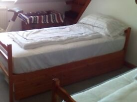 Very strong wooden slatted single beds, reduced for quick sale.