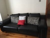 2 x 3 seater blacK leather with anti-sag cushions. Would suit large living room