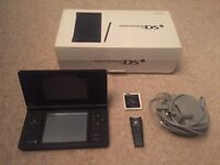 Immaculate DSI boxed with Game Card containing over 60 games