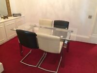 Glass 4 to 6 seater dining table and chairs