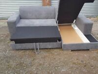 Lovely Brand New grey fabric corner sofa bed with storage. Can deliver