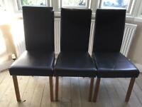 Three faux leather brown chairs