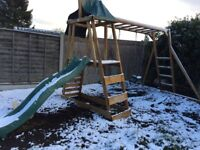 Wooden garden swing set dumpster house