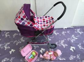 Mamas & Papas toy pram and La Newborn doll with accessories