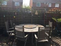 Teak Round table with lazy Susan, bought from Reggata Garden furniture, 6 reclining/foldable chairs