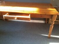 large pine wood dining table.