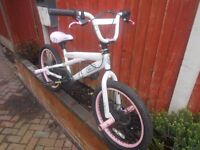 GIRLS STUNT BMW BIKE WITH STUNT PEGS WAVY DISC BRAKES PEARL WHITE LITTLE USE COST £169