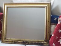 Gold effect framed wall mirror