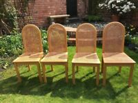 4 dining chairs, 2 in need of a little restoration as shown in photos.